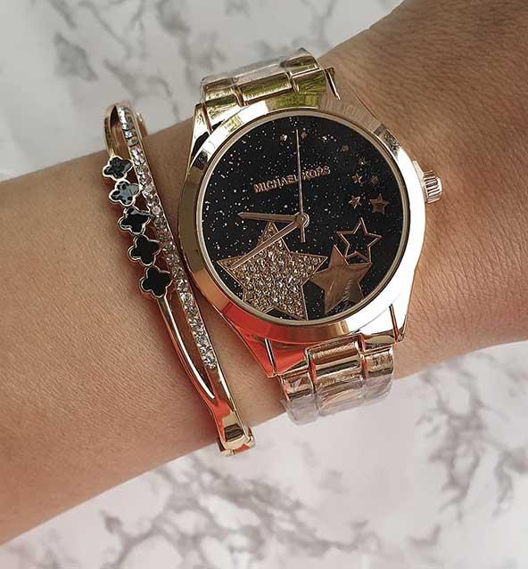 ساعت اصل زنانه با طرح ستاره و بند فلزی